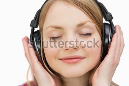 Quiet woman lying down on bed listening music Stock photo © wavebreak_media