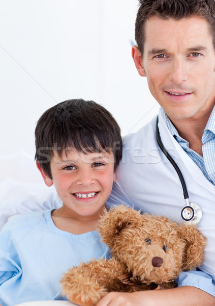 Stock photo: Portrait of a cute little boy and his doctor