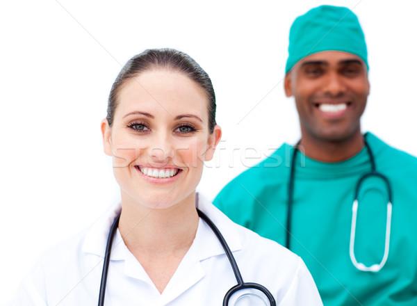 Charismatische artsen permanente rij witte glimlach Stockfoto © wavebreak_media