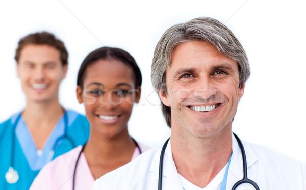 Tolakodó orvosi csapat áll fehér mosoly Stock fotó © wavebreak_media