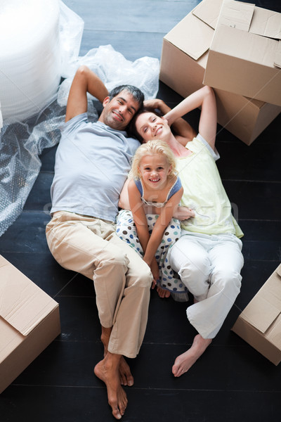 Parents and daughter on the floor with a lot of boxes Stock photo © wavebreak_media