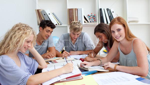 улыбаясь подростков изучения библиотека образование девушки Сток-фото © wavebreak_media