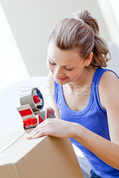 Beautiful woman packing boxes in the living-room Stock photo © wavebreak_media