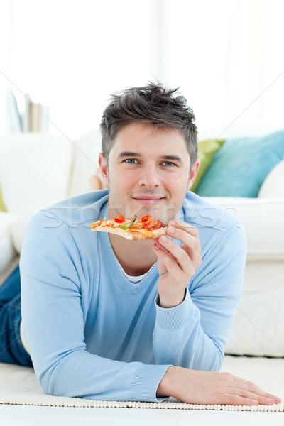 Jonge man pizza glimlachend man grond Stockfoto © wavebreak_media