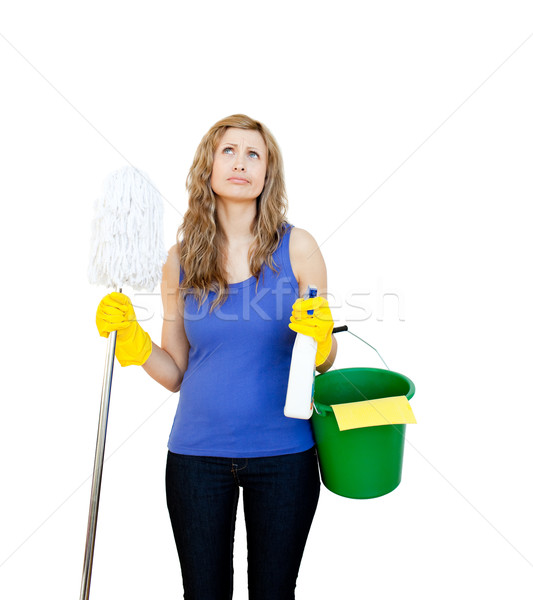 Thinking woman with cleaning utensils against white background Stock photo © wavebreak_media