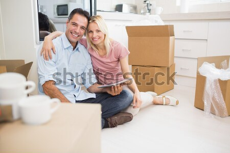 Delighted couple moving house sitting on the floor Stock photo © wavebreak_media