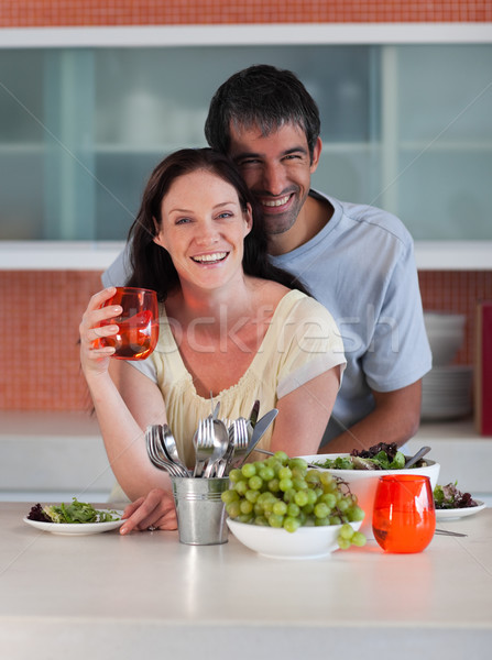 Intimate couple standing in the kitchen smiling at the camera Stock photo © wavebreak_media
