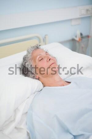 Dulce nina sesión cama hermano mujer Foto stock © wavebreak_media