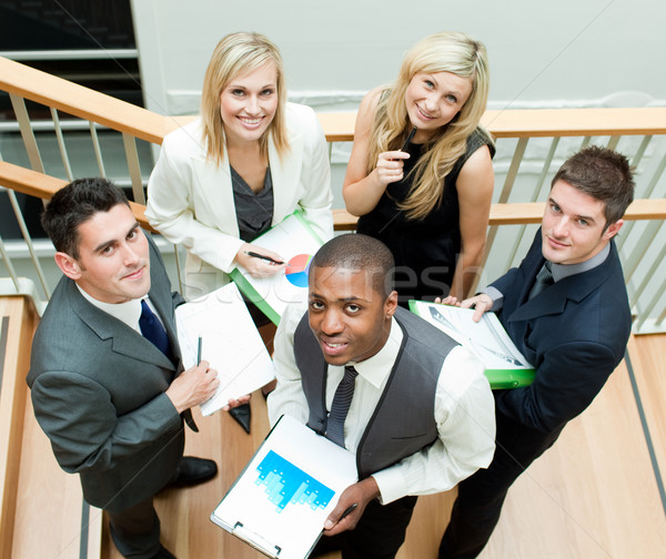 Young business team working on stairs and smiling at the camera Stock photo © wavebreak_media