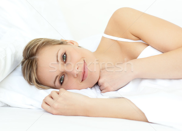 Relaxed woman lying in bed at home Stock photo © wavebreak_media