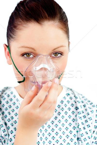 Mulher jovem máscara de oxigênio olhando câmera branco médico Foto stock © wavebreak_media