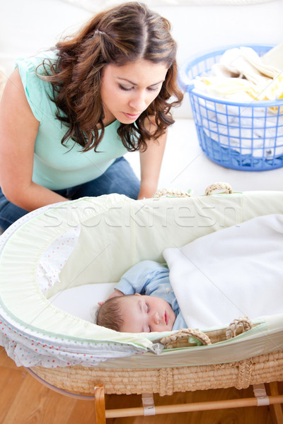 Young mother looking at her little son sleeping in his bed Stock photo © wavebreak_media