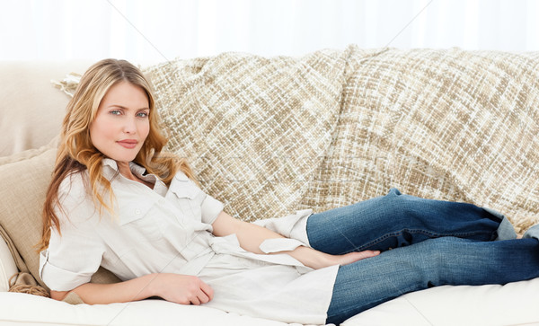 Stock photo: Wonderful woman lying down on her sofa
