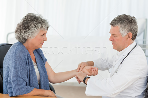 A senior doctor doing an examination of his patient in his office Stock photo © wavebreak_media