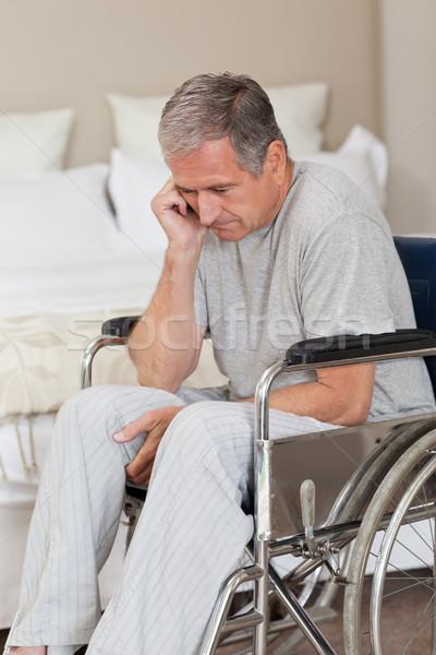 Thoughtful senior man in his wheelchair Stock photo © wavebreak_media