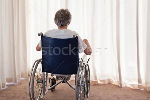 Mulher madura cadeira de rodas de volta casa médico Foto stock © wavebreak_media