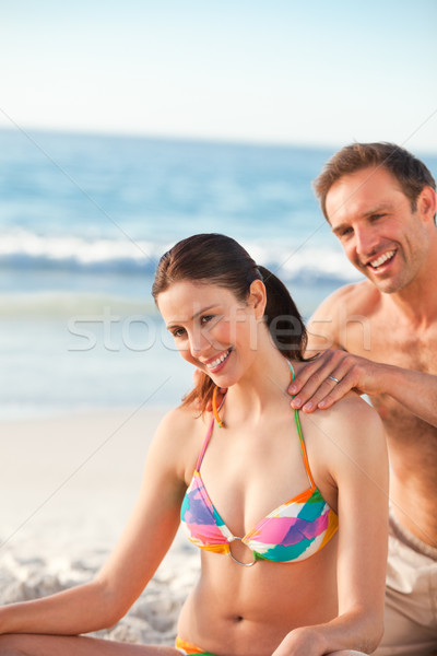 Happy man applying sun cream on his girlfriend Stock photo © wavebreak_media