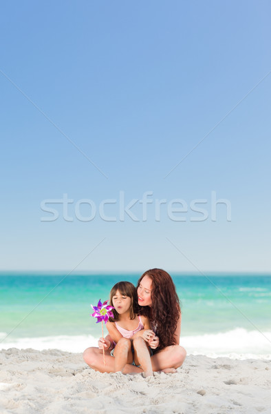 Little girl and her mother with a windmill Stock photo © wavebreak_media