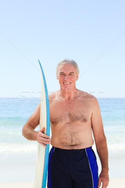 Retraite homme planche de surf plage sourire sport Photo stock © wavebreak_media