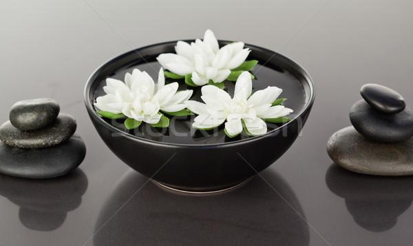 Fleurs noir cailloux fleur Photo stock © wavebreak_media