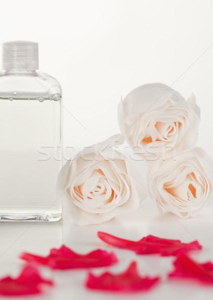 Stock fotó: Rózsaszín · szirmok · üveg · flaska · rózsák · víz