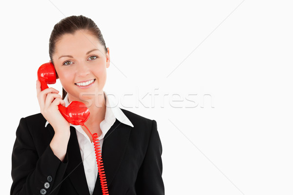 Jól kinéző női öltöny telefon áll fehér Stock fotó © wavebreak_media