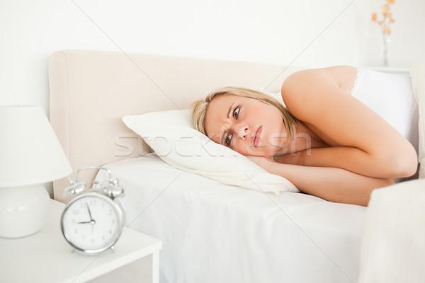 Unhappy woman waking up in he bedroom Stock photo © wavebreak_media