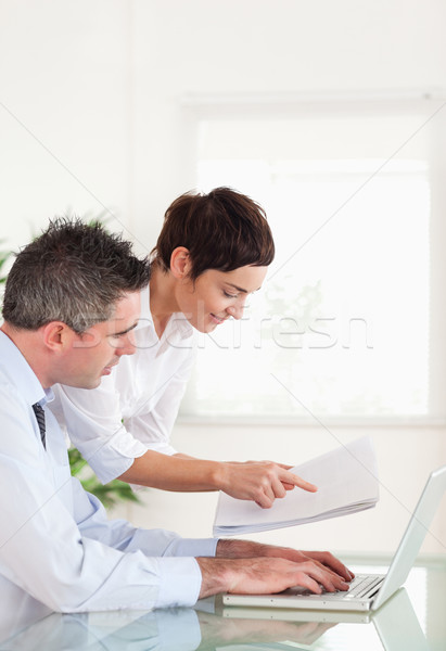 Portrait of colleagues comparing a blueprint folder to an electronic one in an office Stock photo © wavebreak_media