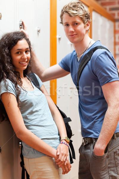 Portrait of a happy couple flirting in a corridor Stock photo © wavebreak_media