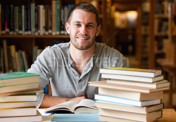 Sorridente estudante livros biblioteca livro trabalhar Foto stock © wavebreak_media