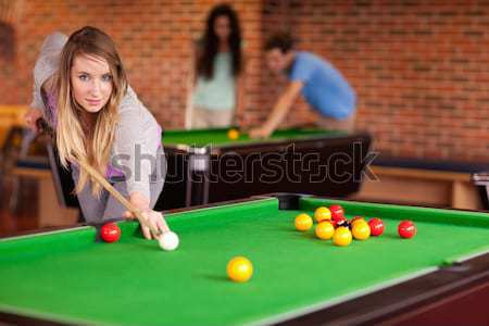 Portrait of a man starting a pool game with the camera focus on the balls Stock photo © wavebreak_media