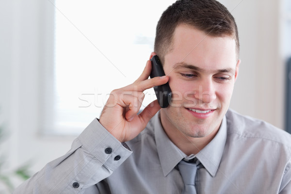 Concentrated businessman listening closely to caller Stock photo © wavebreak_media