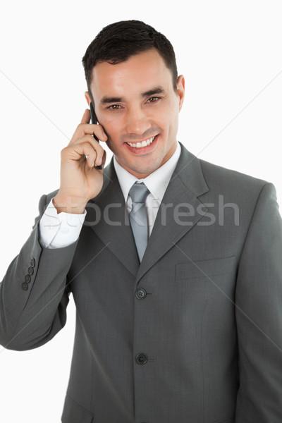 Amigável sorridente empresário telefone branco tecnologia Foto stock © wavebreak_media