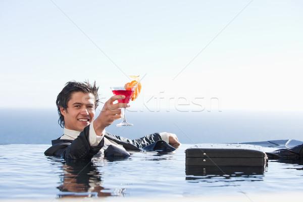 Foto stock: Alegre · empresário · relaxante · piscina · coquetel · terno
