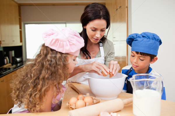 Mother making cookies together with her kids Stock photo © wavebreak_media