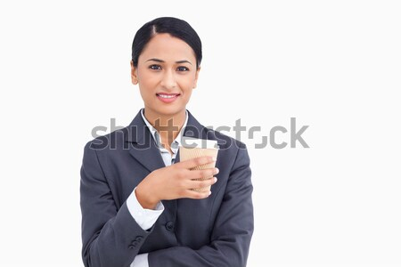 Close up of smiling saleswoman with paper cup against a white background Stock photo © wavebreak_media