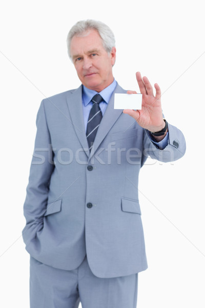 Mature tradesman presenting his business card against a white background Stock photo © wavebreak_media