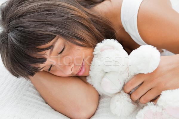 Hermosa dormir osito de peluche cama blanco Foto stock © wavebreak_media