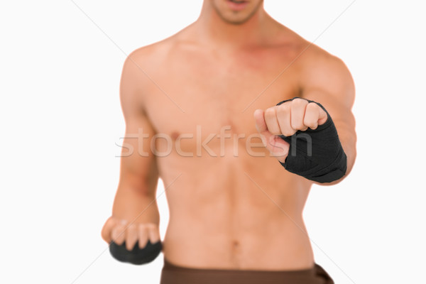 Martial arts fighter doing his exercises against a white background Stock photo © wavebreak_media