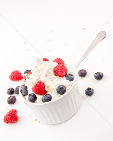 Whipped cream mix with berries and spoon Stock photo © wavebreak_media