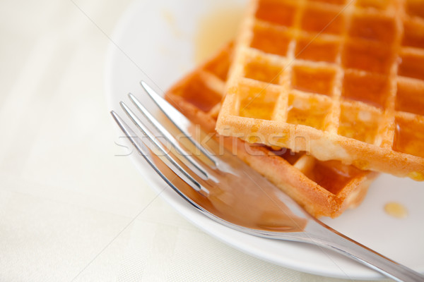 Two waffles and a fork on a saucer on a table Stock photo © wavebreak_media