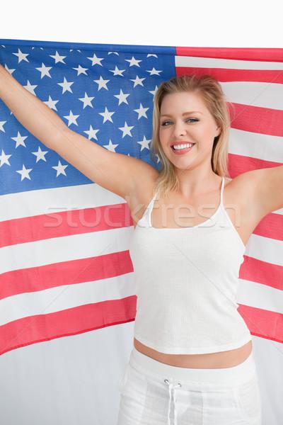 Feliz mulher loira velho glória bandeira Foto stock © wavebreak_media