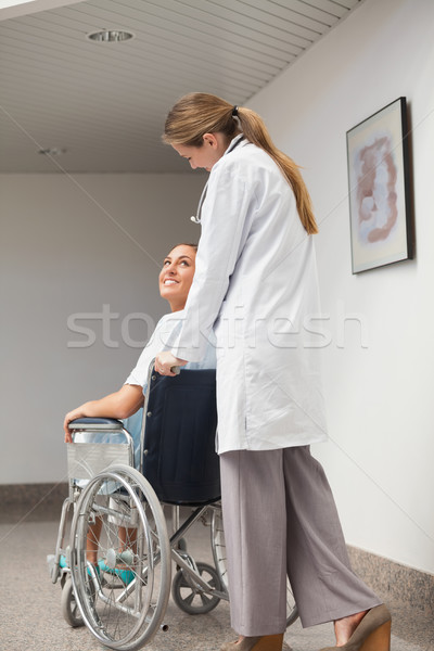 Patient sitting on a wheelchair looking at a doctor in hospital ward Stock photo © wavebreak_media