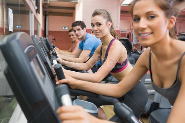 Stockfoto: Vier · mensen · oefening · fietsen · gymnasium · sport