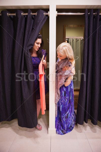 Woman standing in a changing room talking  Stock photo © wavebreak_media