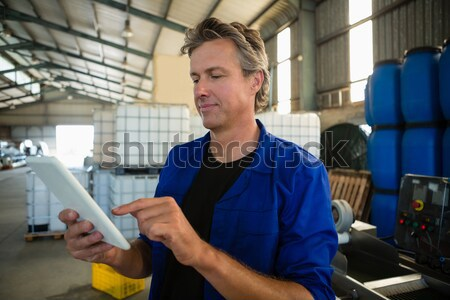 Technician working on tablet pc beside servers in data center Stock photo © wavebreak_media