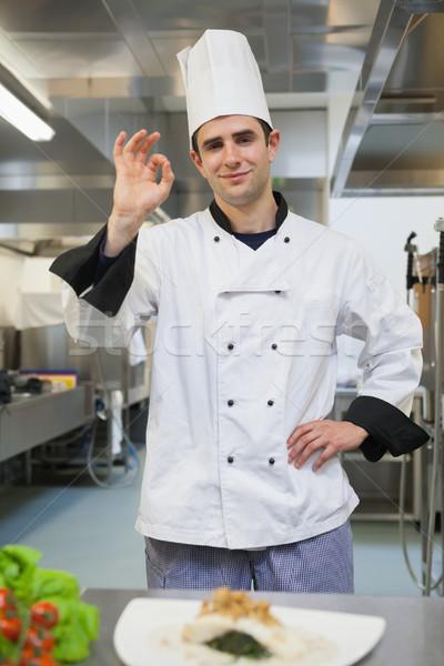 Smiling chef giving ok symbol in the kitchen Stock photo © wavebreak_media