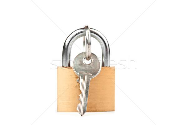 Padlock with key hanging from it Stock photo © wavebreak_media