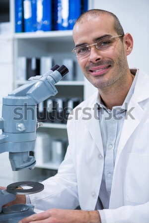 Man smiling while doing server maintenance with tablet Stock photo © wavebreak_media