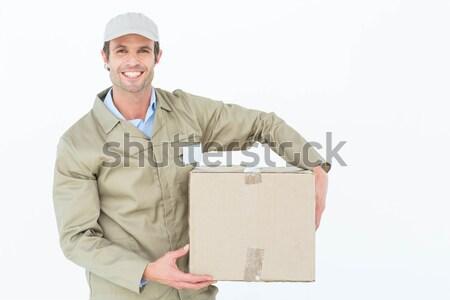 Courier man carrying cardboard box Stock photo © wavebreak_media